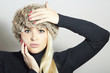 Beautiful Fashion Blond Woman in Fur Cap. Beauty Girl. Winter