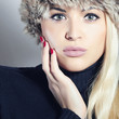Close-up Beautiful Blond Woman in Fur Cap. Beauty Girl. Winter