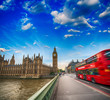 Westminster Bridge traffic at sunset. Blurred Red Bus crossing t