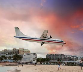 Passenger airplane few moments before landing near the beach
