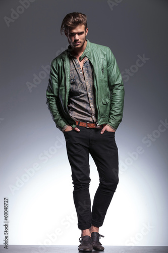 fashion man in leather jacket posing