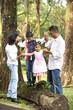 indian family teaching children to climb