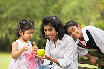 indian family outdoor eating healthy photo