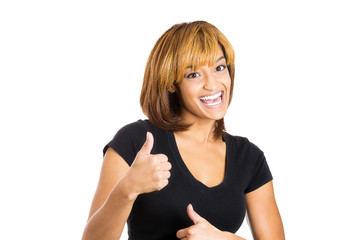 Happy, smiling young woman giving thumbs up