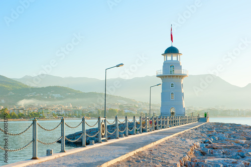 old lighthouse in Alanya on the background of mountains