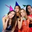 Joyful teen girls have fun on birthday party