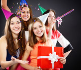 Joyful happy smiling teen girls have fun on birthday party