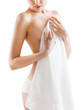 Young nude woman with towel on white