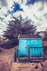 Beach hut against dramatic sky