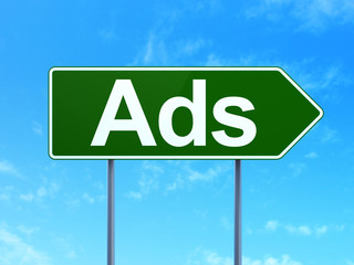 Marketing concept: Ads on road sign background