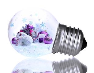 Christmas decorations inside light bulb isolate on white