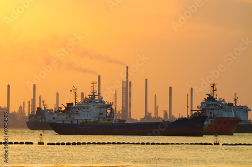 Tanker ships in front of refinery.