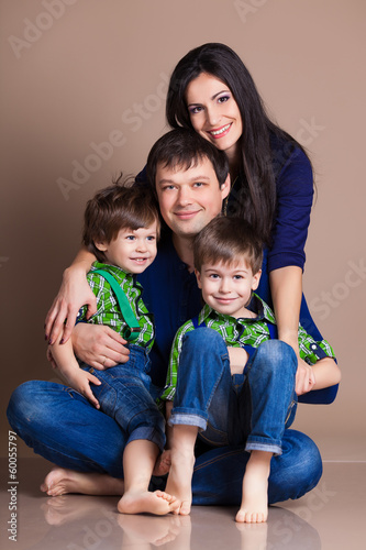Portrait of happy fun beautiful family with two children
