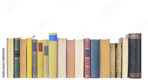 vintage books in a row, isolated on white background, free copy