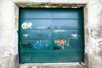 Old metal gate with graffiti, Toulouse, France