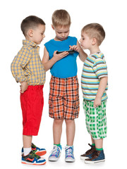 Boys playing with a new gadget
