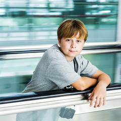 boy on moving staircase