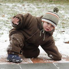 Child on slippery pavement