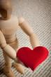 Quadro manichino e cuore rosso