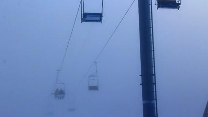 Ski lift in fog.