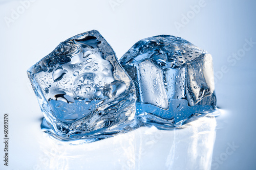 Ice cubes with drops isolated