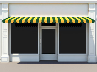 Shopfront - classic store front with green and yellow awnings