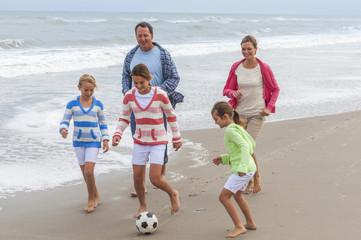 Family Parents Children Playing Beach Soccer Football