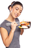 Beautiful young woman with a plate of sushi. Isolated on white b