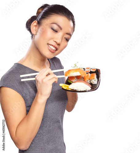 Beautiful young woman with a plate of sushi. Isolated on white b - 60062752