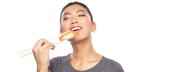 Japanese woman enjoy sushi