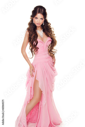 Full-length portrait of a lovely woman in romantic pink dress is