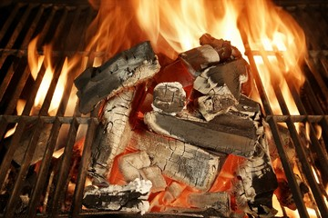 Glowing charcoal and flames in barbecue grill XXXL