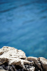Rocks , sea and blue water background