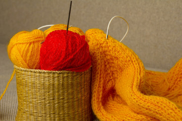 Multicolored yarn in wicker basket