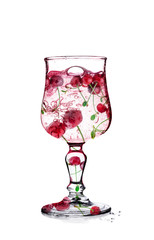 Cherry in glass Isolated on white, with clipping path