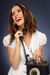 Cheerful young woman on the phone