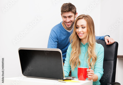 Young couple working with laptop