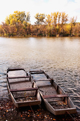 Flat boats on the backwater in autumn,Hungary