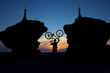 silhouette of a cyclist between two stupas on the background of