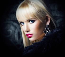 Beautiful blonde girl in luxury fur coat