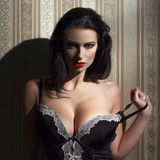 Sensual brunette woman at night portrait