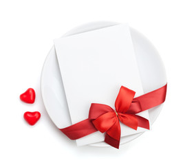 Valentine's Day love letter over plate with red bow