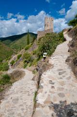 Walking path and La Tour Regine tower at Lastours