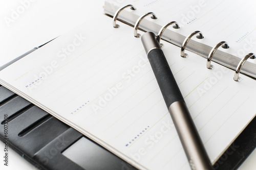 notebook and pen on white isolated