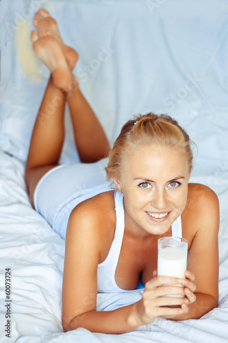 woman drinking milk, indoors