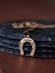 gold jewelry pendant horseshoe - symbol of luck
