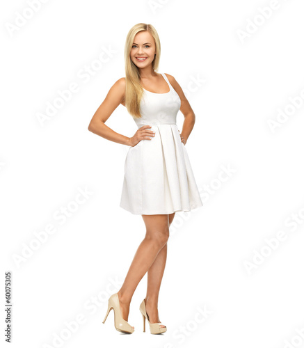 young woman in white dress and high heels