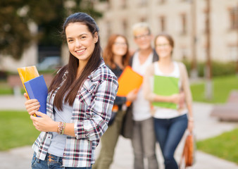 teenage girl with folders and mates on the back