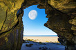 a cave on a beach and Moon