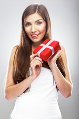 Smiling woman hold Christmass gift.